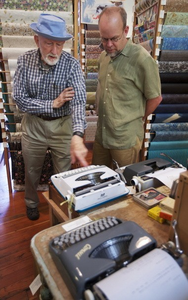 "Oblation Papers & Press co-owner Ron Rich (right) talks with Arthur Springer (left) who came in during the northwest Portland store's ""type-in"" on Sunday, part of International Typewriter Day. Springer uses a manual typewriter to prepare invoices for his business."