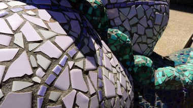 The mosaic sculptures in front of Northwest Portland's Chapman Elementary School have bright colors and surrealist elements like this dragon, but the Marquam Nature Park mosaic will have earth tones. In August, volunteers will start assembling the mosaic.