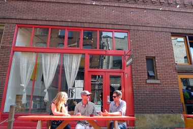 Amanda Tillstrom, with Know Your City, Will Elder, who owns Valentineâs, and Marc Moscato, with Know Your City, chat outside of Valentineâs in Ankeny Alley. Elder says that Know Your Cityâs values mesh with the business ownersâ who run the alley.