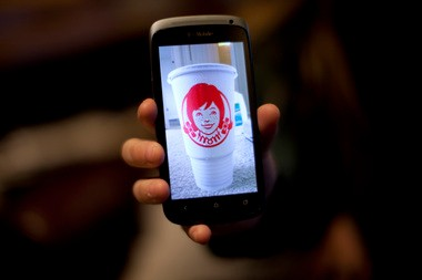 Carlson was so disturbed by the message she saw hidden in a fast-food cup that she took a photo of it with her phone. Do you see what she saw?