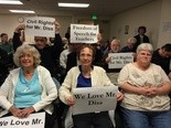 Bill Diss, a former Benson High teacher who claims the district unfairly targeted him for his views on Planned Parenthood, was surrounded by supporters at a Thursday night public hearing.