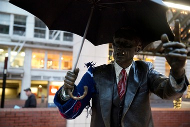 The umbrella guy was looking worse for the holiday wear on Saturday, with his new festive sweater in tatters.