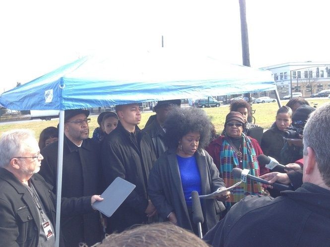 Community leaders and activists meet on the vacant lot that was slated for a Trader Joe's in 2014.