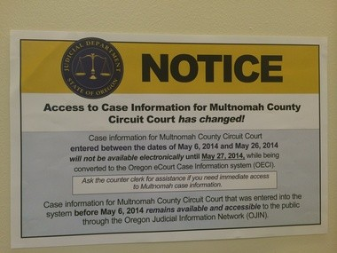 A sign at the Multnomah County courthouse informs visitors of the switch to eCourt.