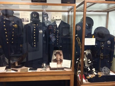 An exhibit in the Portland Police Museum of the different uniforms worn by officers through the years.