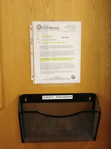 The city's letter exonerating Capt. Mark Kruger of workplace harassment, found posted on his East Precinct office door. The letter did not contain the complainant's name, but the complainant's name was added to the posted letter with red marker. Lt. Kristy Galvan complained Kruger's posting of the letter was an act of retaliation against her. The city agreed.