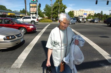 Louise Ferrell makes her way safely across 82nd Avenue at Powell Boulevard in 2007. Safety along the state highway has been a concern for years.
