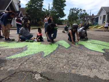 Youth in the anti-violence Yes Empowerment Solutions program began painting a street mural Friday at the intersection of North Borthwick and Killingsworth Court.