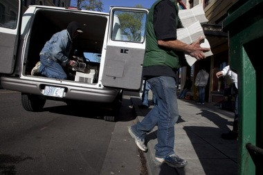 New papers arrive every other Friday. Vendors, many of them homeless, unload the new edition.
