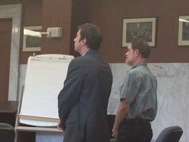 Michael Hutchinson (right) stands next to defense attorney Jonathan Sarre at Hutchinson's plea and sentencing hearing Tuesday.