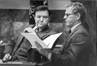 Tom Metzger (left) inspects documents shown to him by attorney Morris Dees during the civil liability case in the death of Mulugeta Seraw.