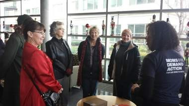 Oregon members of Moms Demand Action for Gun Sense in America deliver a petition to Fred Meyer headquarters in Portland on Tuesday asking that the retailer prohibit customers from openly carrying guns in its stores.