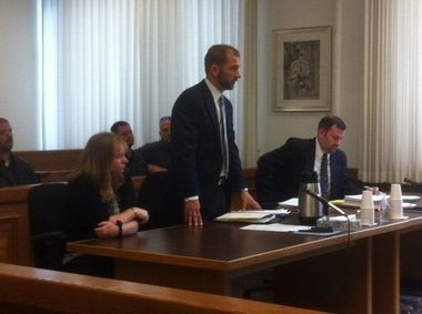 Kimberly Janelle Vollmer (left) listens in July 2013 to her attorney, Bryan Francesconi (center), speak on her behalf because she said she was too choked up to speak. Prosecutor Chuck Mickley is seated on the far right.