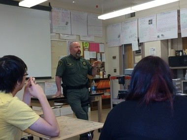 Deputy Bret King speaks to students at Franklin High School after showing his new anti-drug campaign From Drugs to Mugs.