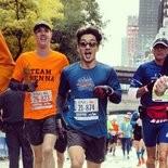 Gene Lu, center, shown running in the 2013 New York City Marathon.