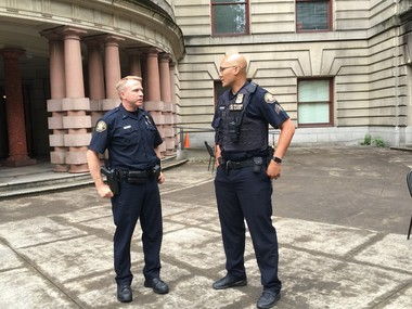 """Portland's Central Precinct Sgt. Mike Leasure, on right, lingers after the news conference to chat with newly-promoted Assistant Police Chief Matt Wagenknecht. """"It's a tough day for our profession. A lot of us are still processing it. It's still fresh. It's an emotional time for everyone involved.''"""