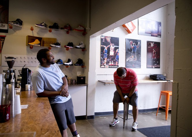 Ian Williams, left, owner of Deadstock Coffee, talks with Steven Green, a Portland economist who is active in supporting black-owned businesses in the city. Green is a regular at the shop. August 4, 2016. Beth Nakamura/Staff