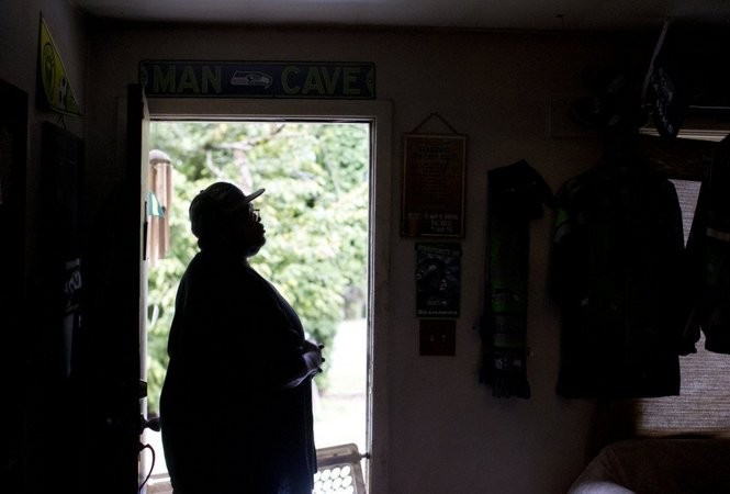 Larnell Bruce Sr. looks out the front door of his Vancouver home. His son Larnell Bruce was killed in Gresham in August. Beth Nakamura/The Oregonian/OREGONLIVE