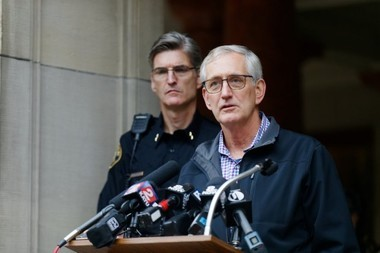 Mayor Charlie Hales appears with Police Chief Mike Marshman, left, at a news conference at Portland City Hall regarding recent civil unrest in the wake of the election of Donald Trump, Nov. 11, 2016. Dave Killen/Staff