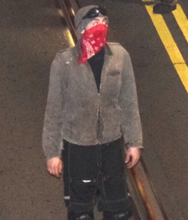 "Portland police have released this photo of a suspected rioter on the bureau's ""CanYouIDME?"" web page in hopes that the public will help identify him. (Portland Police Bureau)"