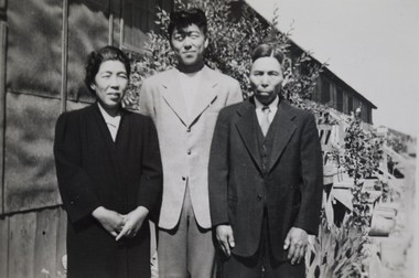 "Henry ""Shig"" Sakamoto, center, with his parents Hisano, left, and Hintaro, on the last day of his internement at the Minidoka War Relocation Center (Japanese internment camp) in Idaho."