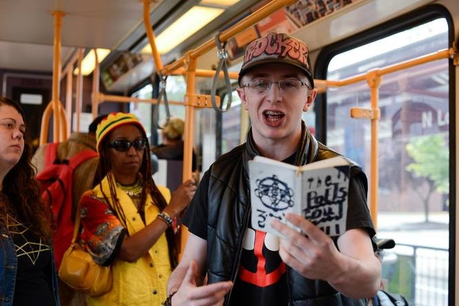 Micah Fletcher reads poetry on the MAX on Memorial Day weekend 2016. This year, he was one of three men attacked with a knife by a man accosting two women, one of whom was wearing a hijab. Micah is the only one to survive.