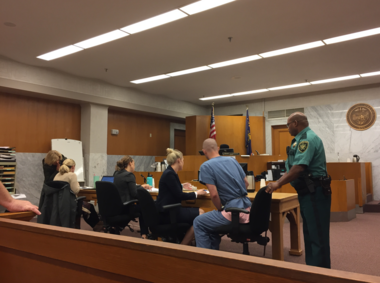 Steven Klopp (wearing a blue jail uniform) pleaded guilty to second-degree intimidation in Multnomah County Circuit Court in September.