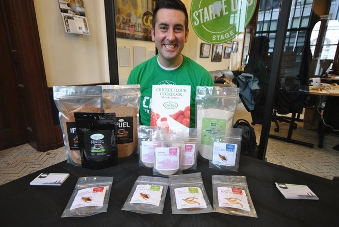 Charles Wilson with the product line from his start-up business Cricket Flours, which sells roasted and milled cricket flours and baking ingredients.