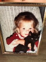 Brook McCall, little girl with her cat.