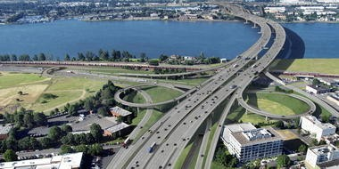 This artist's rendering shows what a 12-lane I-5 bridge could look like, viewed from Vancouver, with light rail and a bicycle-pedestrian path built underneath two bridge structures.