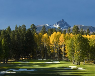 Keeping your eye on the fairway isn't always easy with the sight of the Cascades' Three Fingered Jack looming in the distance.
