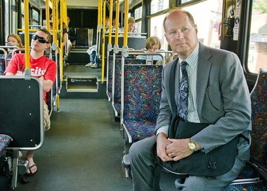 """Neil McFarlane, seen in this file photo on his morning bus ride from his home in Southwest Portland to his office at TriMet's Central Garage, says The Oregonian story """"shoudl find us all reflecting on how we run our business..."""""""