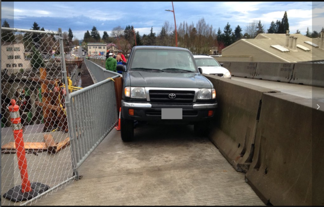 Truck wedged between barriers on the new Sellwood Bridge.