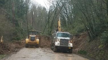 Crews work to clear the landslide on West Burnside.