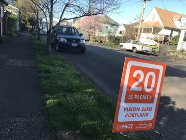 Portland is blanketing neighborhoods with orange signs urging drivers to follow the new 20 mph speed limit.