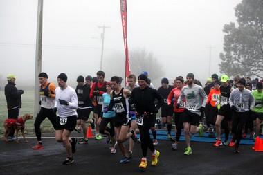 Runners leaving the start line