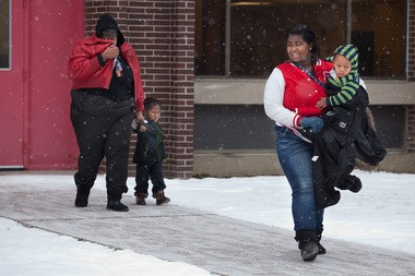 Students are taken from a school in Flint, Mich, after a lockdown due to a report of a gun.