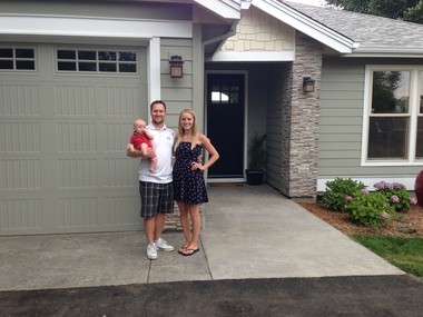 Ryan and Andrea Garrow, and their 4-month-old son Winston, moved into the Bowmen House this week, built by more than 300 Sherwood High School students.