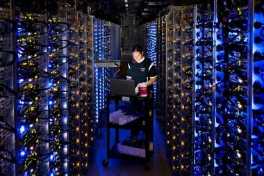 A technician at work inside Google's data center in The Dalles.