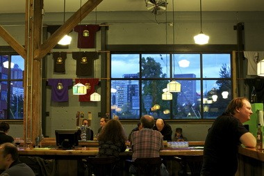 The Hair of the Dog tasting room in inner Southeast Portland offers the kind of funky atmosphere that the city hopes will draw young tech companies across the river.
