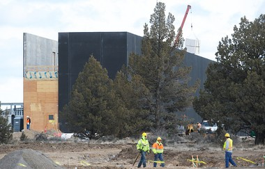 Apple started work last fall on its Prineville data center. The company hasn't said when it will open, but a massive black wall is already visible from the street.