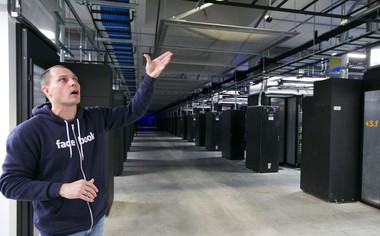 "Josh Crass, manager of Facebook's Prineville data center, inside an existing ""hot storage"" facility."