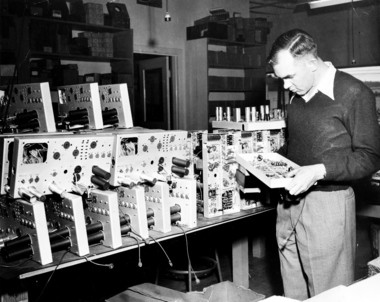 Howard Vollum inspects oscilloscopes in the company's Southeast Portland offices in May 1949. Tek was three years old at the time and demand for its scopes was high -- customers had to wait months for delivery.