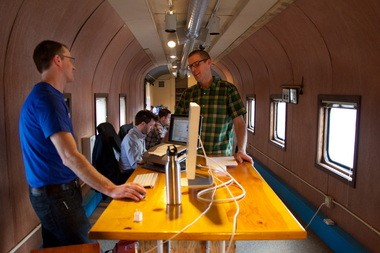 The Your Brandlive crew, from left: Fritz Brumder, Josh Cox, Tony Pullen, and Ben McKinley. The startup's offices are located in the renovated railroad cars next to OMSI.