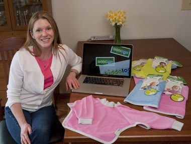 Laurie O'Nion, founder of Kiddologic, with the startup's first product, the Bibit-all, a bib for both toddlers and infants.
