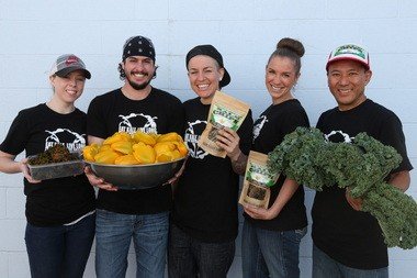 The staff of Pacific Northwest Kale Chips. From left: Briana Kelly, Daniel Padrick, co-founder Sarah Pool, Lisa Pool, and co-founder Ugyen Shola. Sarah Pool and Ugyen Shola, both practicing Buddhists, met while working for a Buddhist-based nonprofit in Portland, and decided to open their business after trying kale chips at a Farmer's Market.