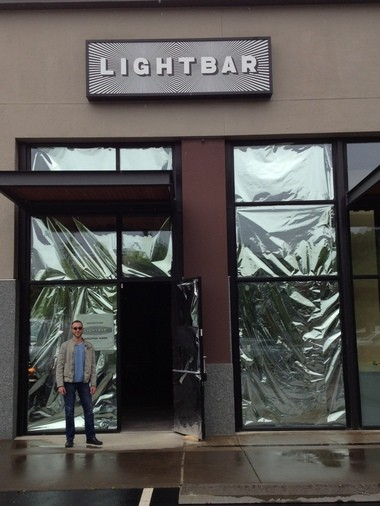 Alex Carlson in front of his new light therapy cafe, Lightbar, which is set to open June 3.
