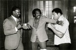 Thad Spencer, left, never got to fight Muhammad Ali, right, since Ali was stripped of his heavyweight title for his refusal to serve in the U.S. military. Ali attended an event in 1993 for Spencer's 50th birthday.