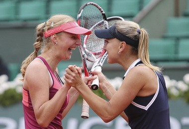 Ekaterina Makarova and Elena Vesnina celebrate winning the French Open women's doubles title.