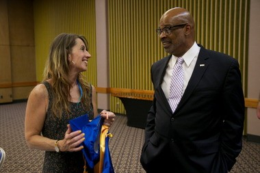 Michelle Reers, PCC's student speaker this year, chats with Dr. Preston Pulliams, PCC president before the graduation ceremony.